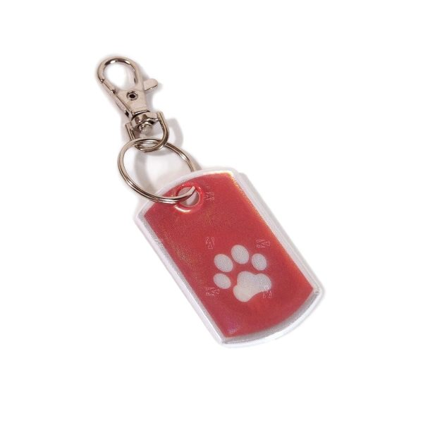 dog tag with white paw print on red background